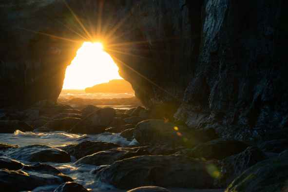 sun rays in a dark cave - hope is infinite