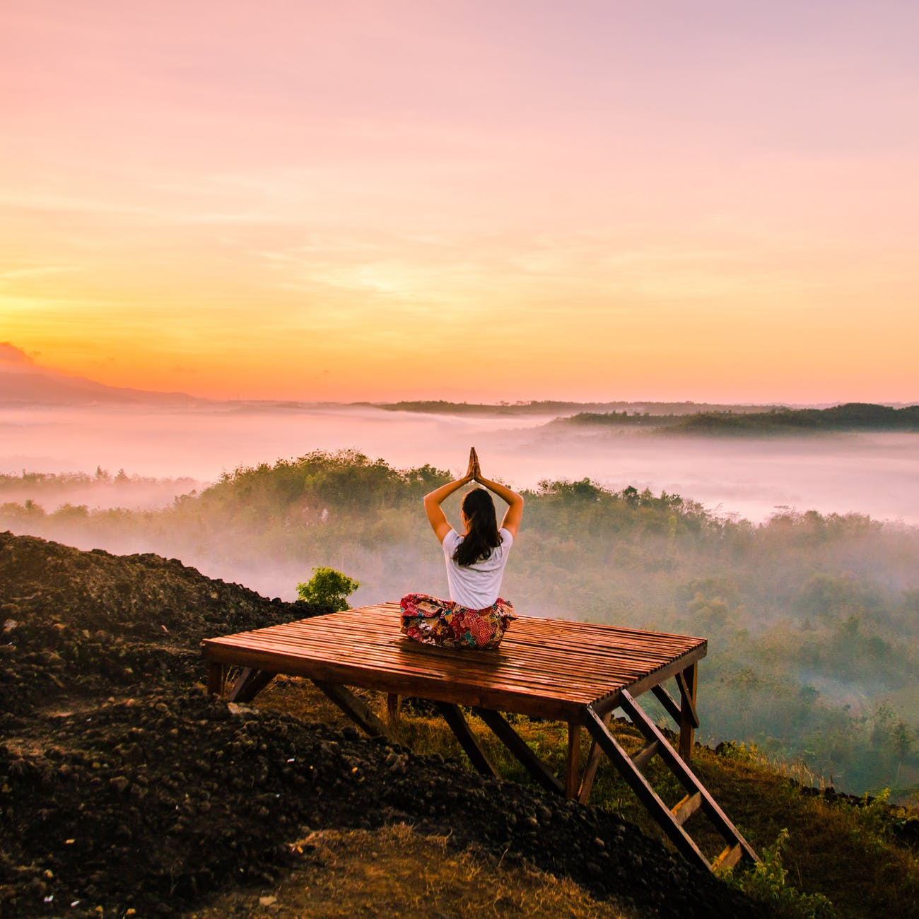 woman yoga meditation at sunrise, self-care or sharpening the saw